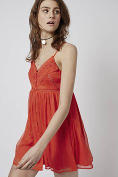 Embrace the sunshine in a classic babydoll sundress during the warmer months. Crafted from a soft woven fabric, we adore the pretty embroidered applique details. Featuring a button up front, it comes finished with dainty straps and is perfect for complimenting sun-kissed skin. #Topshop