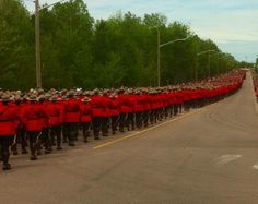 Thousands gather in Moncton, N.B. to pay respect to three slain RCMP officers.