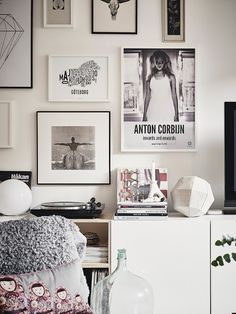 Love this black and white asymmetrical gallery wall. Great interior design inspiration for the bedroom of a sophisticated teen.