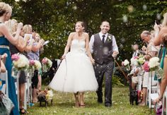 bubble wedding exit with couple walking dogs