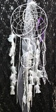 """""""Angels Dreams"""" dreamcatcher with fluorite, amethyst and clear quartz made by a Vancouver Island artist. www.suzannart.com #dreamcatcher #feather #white #dream #crystal #goodvibes #suzannart Vancouver Island, Clear Quartz, Dream Catcher, Angels, Feather, Amethyst, Dreams, Crystals, Gallery"""