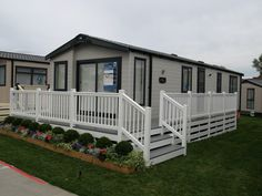 white and driftwood Fensys decking on Swift holiday home