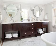 This double vanity with the dark wood base and light marble countertop has a rich, luxurious feel.