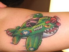 Fighter vintage airplane tattoo by Tim Senecal of Easthampton, MA