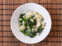 Sautee garlic in olive oil, then add spinach until wilted. Stir into oatmeal with salt and squeeze lemon juice on top.
