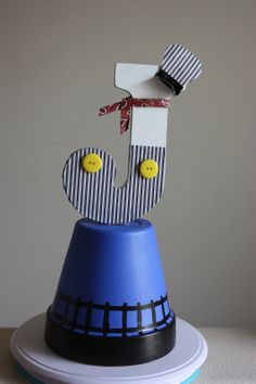 Train conductor centerpiece by Forbiddentink on Etsy, $20.00