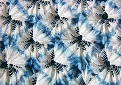 """Wring, press and twist"" is the English translation of the Japanese verb Shiboru. This photo is from Suzusan which is a Japanese textiles company who use tradition shibori methods to create decorative fabrics. Many of their fabrics have a rhythmical patterned design due to the repetitive way that the fabric has been manipulated before dyeing. The work of Suzusan has already featured in collections by designers such as Junya Watanabe, Calvin Klein, Issey Miyake and Yohji Yamamoto."