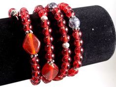 Red glass bead and silver memory wire by WeepingWillowByJanna