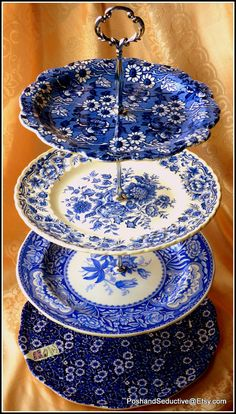 Striking four tier handmade chic cake stand made of best English branded china large various shades of blue and white floral pattern plates
