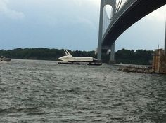 June A barge carrying NASA's space shuttle Enterprise prototype passes beneath a bridge in the New York Harbor during a trip from John F. Kennedy airport to a New Jersey port during delivery. Intrepid Museum, Space Shuttle Enterprise, Sea Trek, Kennedy Airport, New York Harbor, New York Museums, Public Display, Kennedy Space Center, Air And Space Museum