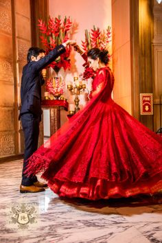 Engagement/Sangeet Outfits - Jai & Nayana wedding story | WedMeGood | Twirling Bride in a Red Flared Net Gown #wedmegood #lehenga #gown #flaredlehenga #red #bridal #gown #indianweddinggown #lehenga