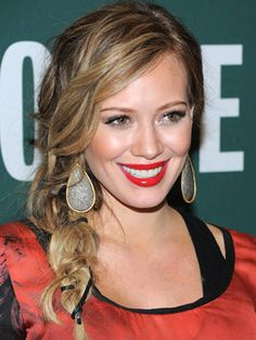 Who says untidy can't be chic? Hilary Duff braids a leather strip of ribbon into her widely plaited side braid for an earthy feel.