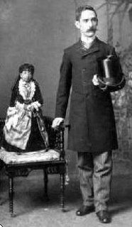Lucia Zarate (1864-1890).  She is the lightest recorded adult at 4.7 lbs at the age of 17.  She never grew above 26 inches and is thought to have been a primordial dwarf.  She had a successful career in the circus sideshow.  She died of hypothermia at age 26 when the circus train she was riding in got stuck in a blizzard.