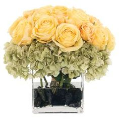 """Faux rose and hydrangea arrangement from Natural Decorations, Inc. Made in the USA.  Product: Faux floral arrangementConstruction Material: Polyester and glassColor: Yellow and greenFeatures: Manufactured in the USADimensions: 11"""" H x 14"""" W x 14"""" DNote: Product supplied by Natural Decorations, Inc."""