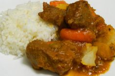 Puerto Rican Carne Guisada recipe: Carne guisada, or beef stew, is a very popular dish in Puerto Rico. It's our version of beef stew but with our ingredients, such as adobo and sofrito, for its signature flavor Puerto Rican Cuisine, Puerto Rican Recipes, Mexican Food Recipes, Beef Recipes, Cooking Recipes, Recipies, Soup Recipes, Comida Latina, Spanish Dishes