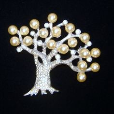 Vintage 1940s Pennino Faux Pearl Rhinestone Tree Brooch Book Patent Pin Offered by Ruby Lane shop The Vintage Carousel