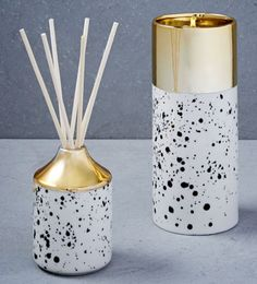 Black and white speckled candle and scented oil diffuser with gold detail cap