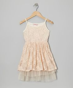 Ladylike and lightweight, this dress features an airy lace overlay and tulle lining under the skirt. A stretchy elastic waistband helps it stay comfy through a girl's daily adventures in looking adorable.100% polyesterMachine wash; hang dryImported