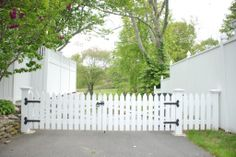 Love the look of a picket fence by the driveway, but privacy fencing around the yard