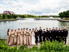Wedding party group photos overlooking the lake fountain at Centennial Park.