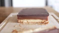 Recipe with video instructions: The popluar Twix candy bar - made from scratch at home.  Ingredients: 100 g butter , ¼ cup sugar, 1 ½  cup all-purpose flour , salt, 2 cups sugar , 2 cups cream , 1 cups condensed milk , 300 g of dark chocolate , 4 tablespoons butter