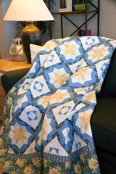 Buttercup & Blue Quilt Kit: Classic florals in blue, yellow and gray from the Blue Drama collection by Marcus Fabrics make this Buttercup and Blue quilt designed by Kate Colleran an instant classic.