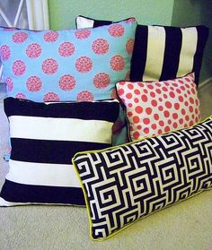love all these pillows! coral and navy