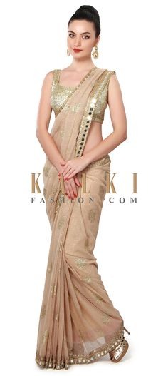 Buy Online from the link below. We ship worldwide (Free Shipping over US$100). Product SKU - 310275. Product Price - $179.00. Product Link - http://www.kalkifashion.com/sand-brown-saree-adorn-in-mirror-embellished-border-only-on-kalki.html