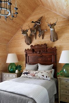 It just feels right to leave the natural wood as-is in a farmhouse bedroom. For avid hunters or collectors, it makes an ideal spot to display hunting mounts. #farmhousedecor #southernliving #homedecor