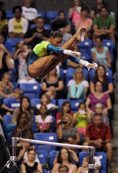 Gabby Douglas competes on the uneven bars during day two of the 2012 Visa Championships
