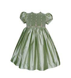 A beautiful sage green flower girls silk dress. Perfect for those fall weddings.