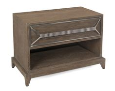 A luxe bedside table with soft weathered greige hardwood detailed and ribbed stainless steel hardware.