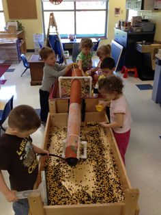 Preschool sensory table with two tables.