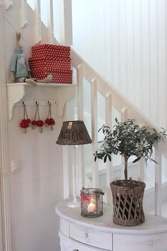 white stairs... with white paneling and adorable decorative items
