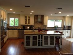 large kitchen island | Large kitchen with painted white cabinets