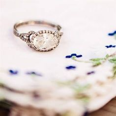 Oval shaped engagement ring, so vintage and different, seriously beautiful_I love my wedding rings but If I got a new one for an anniversary..I'd take this side oval ring!