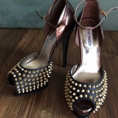 Steve Madden heels with spikes Steve Madden heels, size 8. Heel is about 6 inches, with a 1 inch platform. Bronze/black with gold spikes. Strap fastens around your ankle. Only worn once for pictures, on carpet, then taken off. Steve Madden Shoes Heels