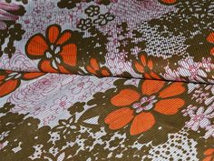 Flowers printed on pure cotton fabric in orange, brown and maroon on white base color. High quality fabrics for patchwork, quilting and other fabric crafts.   You can use this fabric to make...