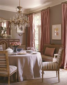 The draperies are reversible...can't believe what a sophisticated room this is - with, none-the-less, PINK!
