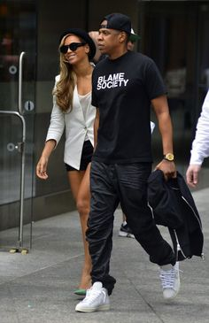 Jay-Z with Beyonce wearing Balmain 'Blame Society' t-shirt