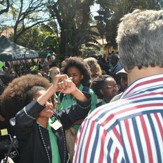 Girls as young as 13 have been forced to straighten or cut their natural afros, sparking protests and a petition that has gathered nearly 20,000 signatures.