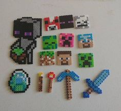 Minecraft pieces made from perler beads. Minecraft Perler, Hama Beads Minecraft, Diy Perler Beads, Minecraft Crafts, Perler Bead Art, Hamma Beads 3d, Hamma Beads Ideas, Fuse Beads, Melty Bead Patterns