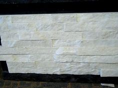 Tile at Best WHITE QUARTZITE STACKED STONE VENEER - white quartzite - ledger panels - stone veneer - stacked stone - rock panels inch interlocking panels per sqft / panel + shipping please call or email for accurate shipping quote . Old Fireplace, Fireplace Remodel, Fireplace Design, Fireplaces, Fireplace Resurfacing, White Quartzite, Stone Veneer, Basement Remodeling, Great Rooms