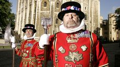 Cheif Yeoman Warder and Yeoman Jailer in front of the White Tower at the Tower of London Tour Site