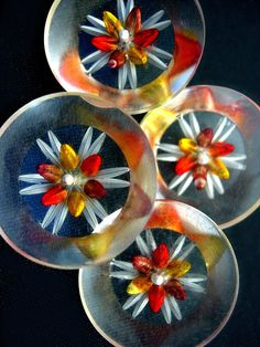 Fun vintage reversed carved lucite buttons with hand painted orange and yellow flowers.
