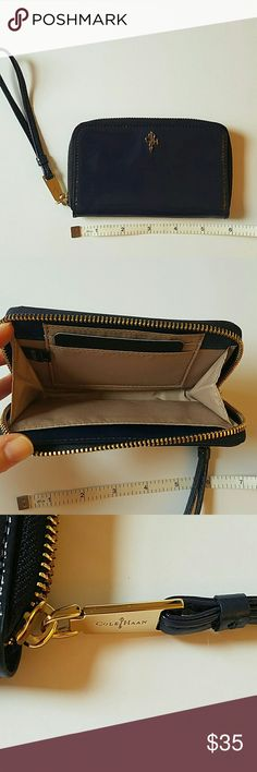 NWT Cole Haan navy leather wristlet NWT Cole Haan navy leather wristlet gold tone hardware, never used!  5 5/8 inches long, 3 1/2 in tall Cole Haan Bags Clutches & Wristlets