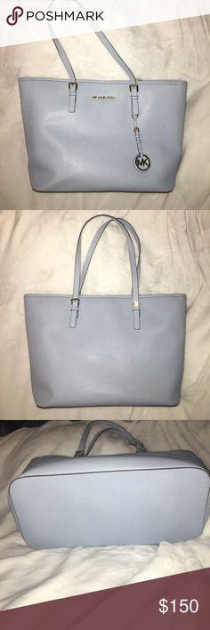 "MICHAEL KORS JET SET TRAVEL MEDIUM TOTE AUTHENTIC Michael Kors Jet Set Travel Medium Saffiano Leather Top-Zip Tote in light blue. 11.5""H X 15""W X 5.5"" D 100% Saffiano Leather, gold-tone hardware Michael Kors Bags Totes"