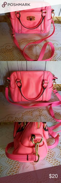 """Pink Merona Purse Handbag Only carried once or twice. Excellent condition. This purse has 2 pockets on the inside and a zippered pocket. On the outside, it has 2 pockets on each side. Also a pocket in the front. Measurements are Strap drop 24"""" adjustable. Height 8"""" Width 10"""" and depth 5.5"""". Thanks for shopping my closet. I send a free gift with every purchase. I ship same day or next day. I offer a discount with all bundles. Make sure that you look through my whole  closet. I have so much…"""
