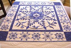 This is a beautiful quilt, fits in with my love of blue and white.