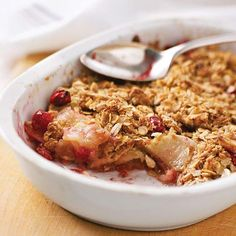 Apple Cranberry Crisp topped with a mixture of oats, brown sugar, and cinnamon. More apple dessert recipes: http://www.bhg.com/recipes/desserts/other-desserts/apple-desserts/